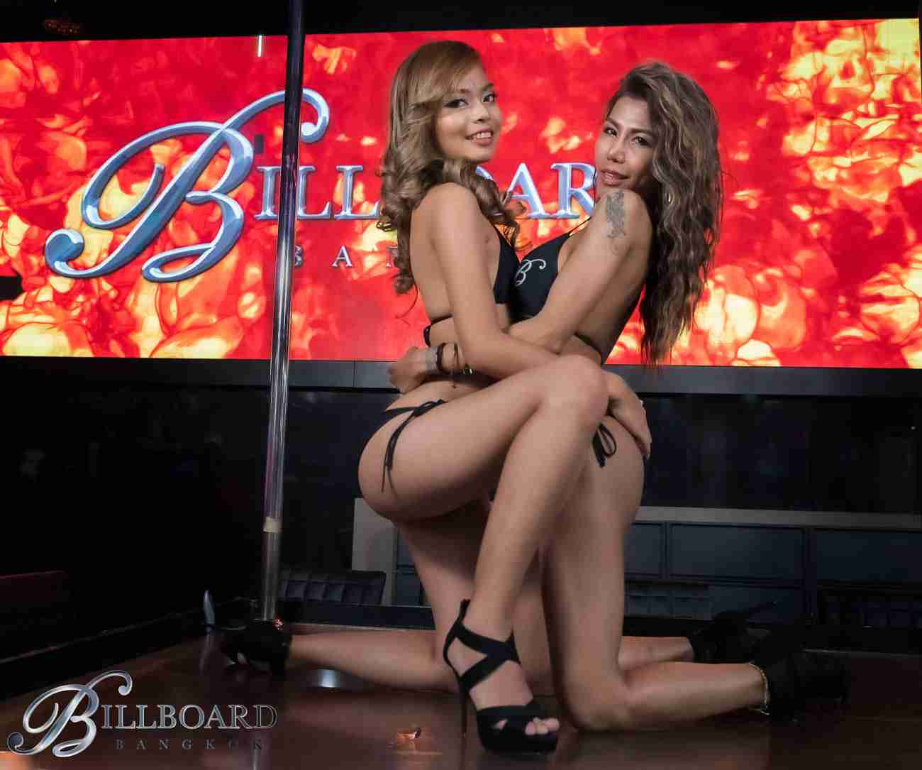 The Billboard Bangkok Babes pose in front of the Nana Plaza Thailand go-go bar's giant LED screen.