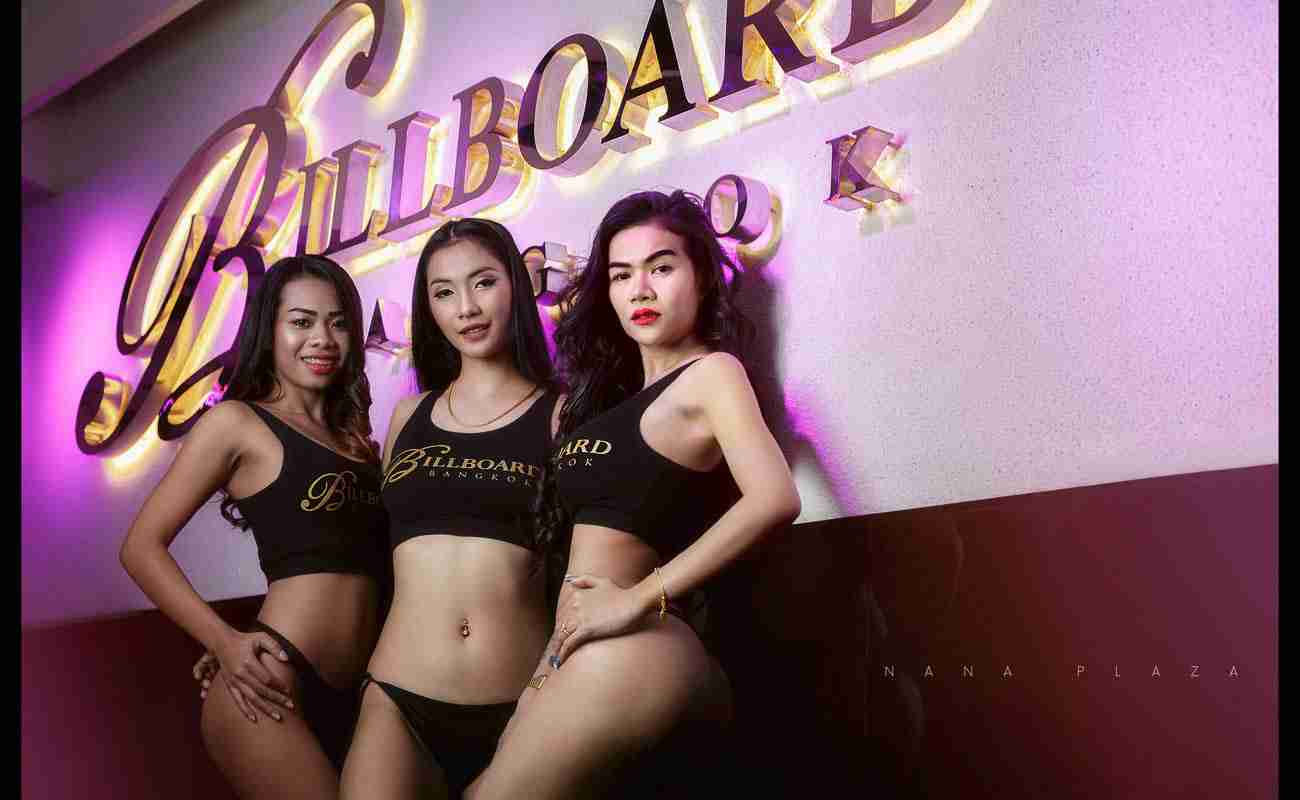 3 Billboard Bangkok Babes Outside at Nana Plaza in front of sign